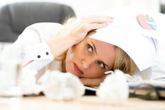 Person under pile of documents surrounded crumpled. Businesswoman under pile of documents surrounded crumpled papers Royalty Free Stock Photos