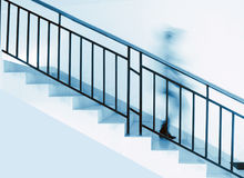 A person is under the stairs Royalty Free Stock Photography