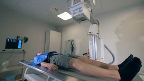 One man undergoing scanning in a hospital room, close up.