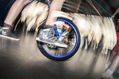 Person on unicycle Stock Image
