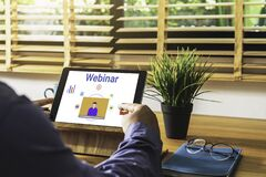 Free Person Using A Tablet Computer For Online Training Webinars. Royalty Free Stock Photo - 187720775