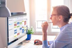 Free Person Using Calendar On Computer To Improve Time Management, Plan Appointments, Events, Tasks And Meetings Efficiently, Improve Stock Image - 185365741