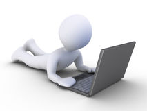 Person is using a computer. 3d person lying on the ground is using a laptop Royalty Free Stock Photo