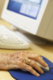 Person using computer. Detail of Senior Person using computer Royalty Free Stock Images