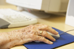 Person using computer. Detail of Senior Person using computer Stock Photography