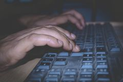 A person using a computer keyboard. royalty free stock photo