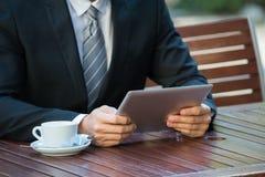 Person Using Digital Tablet fotos de archivo