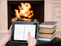 Person using digital tablet PC near the fireplace Stock Photos