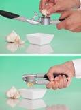 Person using a garlic press Stock Photo