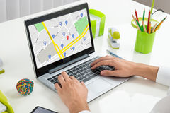 Person Using GPS Map On Laptop Stock Photos