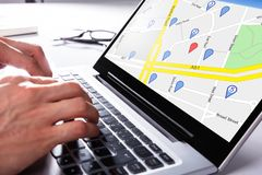 Person Using Gps Map On Laptop. A Person Using Gps Map With Navigation Pointer On Laptop stock photo
