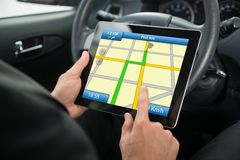 Person using gps service on digital tablet Royalty Free Stock Images