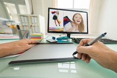 Person using graphic tablet for sketching Stock Photo