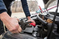 Person Using Jumper Cables To Charge Car`s Dead Battery stock image