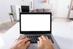Person Using Laptop On Desk fotos de stock
