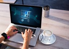 Person using Laptop with Shopping trolley icon Stock Images