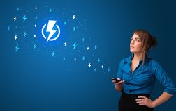Person using phone with power concept royalty free stock photography