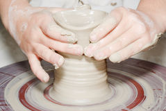 Person using potters wheel Stock Images