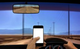 Person using smartphone GPS while driving Stock Photography