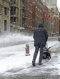 Person using snowblower after snowstorm Stock Photos