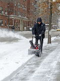 Person using snowblower after snowstorm Royalty Free Stock Photo