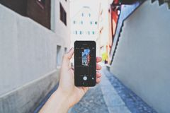 Person Using Space Gray Iphone 5s Taking a Picture of Building during Day Royalty Free Stock Photo