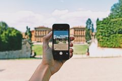 Person Using Space Gray Iphone 5s Taking a Picture of Landmark during Day Stock Photography