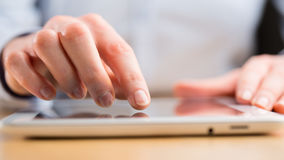 Person Using a Tablet Computer Stock Photography