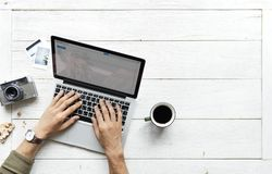 Person Using Tablet Computer Beside Mug and Camera royalty free stock photo