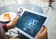 Person using Tablet with Shopping trolley icon Stock Image