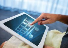 Person using Tablet with Shopping trolley icon Royalty Free Stock Photos