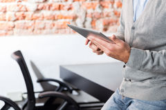 Person using tablet sitting office desk business man Royalty Free Stock Images