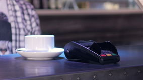 Person using the Terminal and the Phone for wireless payment in cafe. 4K. stock video