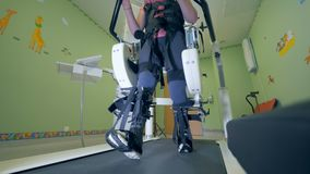 A person is using a walking simulator for disabled people stock video footage