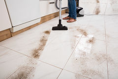 Person Vacuuming The Dust Of The Floor Royalty Free Stock Photo