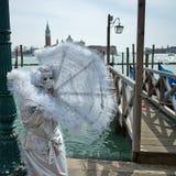 Person in Venetian costume Stock Photo