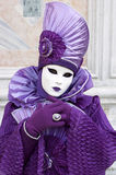 Person in Venetian costume attends Carnival of Venice. Royalty Free Stock Image