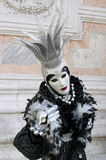 Person in Venetian costume attends Carnival of Venice. Royalty Free Stock Photo