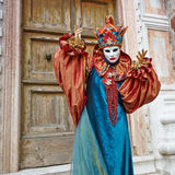 Person in Venetian costume attends Carnival of Venice. Royalty Free Stock Images