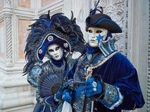 Person in Venetian costume attends Carnival of Venice. Stock Image