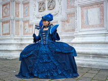 Person in Venetian costume attends Carnival of Venice. Royalty Free Stock Photos
