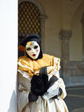 Person in Venetian costume attends Carnival of Venice. Stock Photography