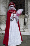 Person in Venetian costume in Carnival of Venice. Stock Photo