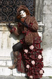Person in Venetian costume in Carnival of Venice. Royalty Free Stock Images