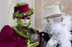 Person in Venetian costume in Carnival of Venice. Royalty Free Stock Photos