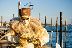Person in Venice carnival mask Stock Photos