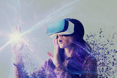 A person in virtual glasses flies to pixels. The woman with glasses of virtual reality. Future technology concept. The woman with glasses of virtual reality Royalty Free Stock Photo