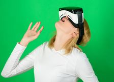 Person with virtual reality helmet isolated on green background. Woman with virtual reality headset. Cyber game. Person with virtual reality helmet isolated on stock photo