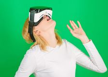 Person with virtual reality helmet isolated on green background. Woman with virtual reality headset. Cyber game. Person with virtual reality helmet isolated on stock image