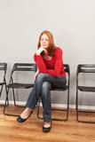 Person in a waiting room Royalty Free Stock Image